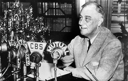 Franklin D. Roosevelt recording his fireside chat on Christmas Eve 1943